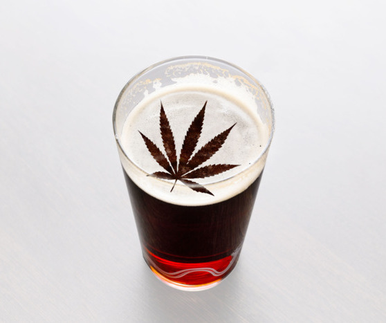 an image  of a pint with a marijuana leaf in the foam