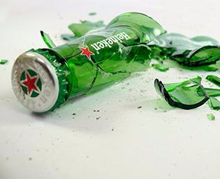 A broken Heineken bottle to symbolize the broken promises they made