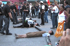 Protestors lay on the ground in Whiteclay