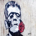 A Banksy-style street art piece of Frankenstein with a carnation in his mouth