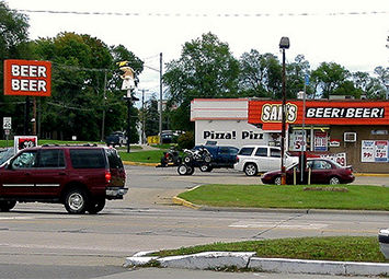 A beer outlet in Michigan, multiple signs reading BEER BEER
