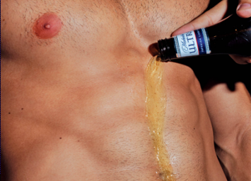 Pale yellow Michelob Ultra pours down a stubbled once-shaven chest